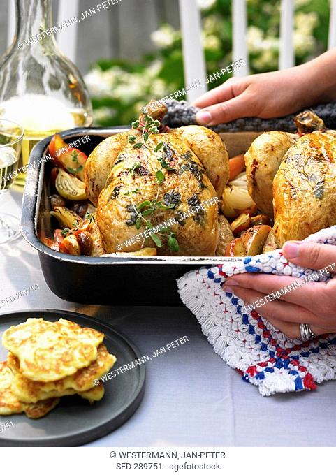 Chicken with apples and chestnuts and potato pancakes