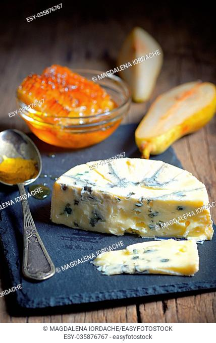 Blue Cheese and honey on ardesia plate