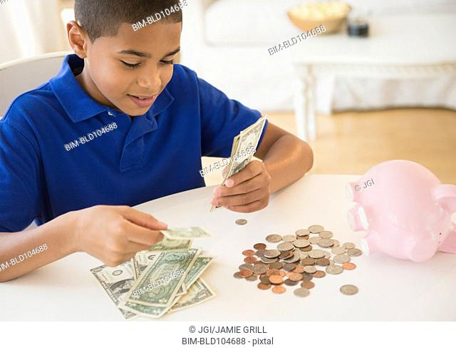 Hispanic boy counting money