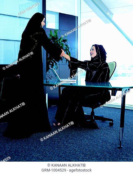 Arab businesswomen greeting each other
