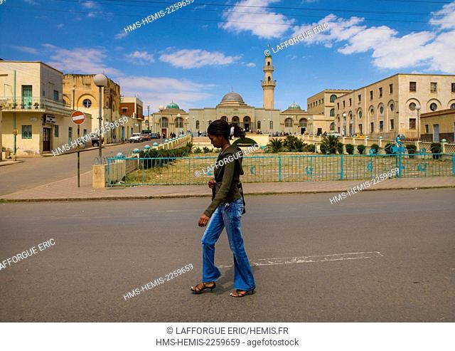 Eritrea, Horn Of Africa, Asmara, woman passing in front of grand mosque kulafa al rashidin