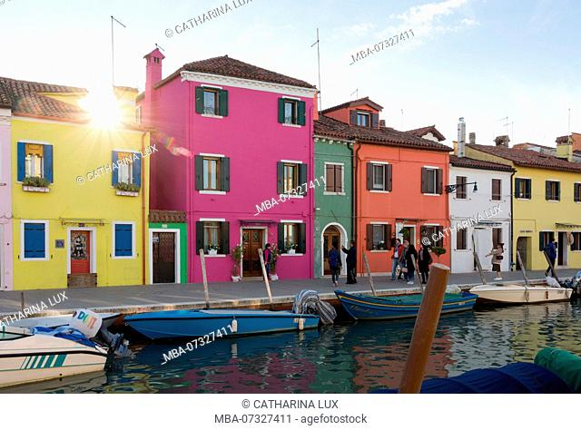 Venetian lagoon, island of Burano, colourful facades, sunbeams