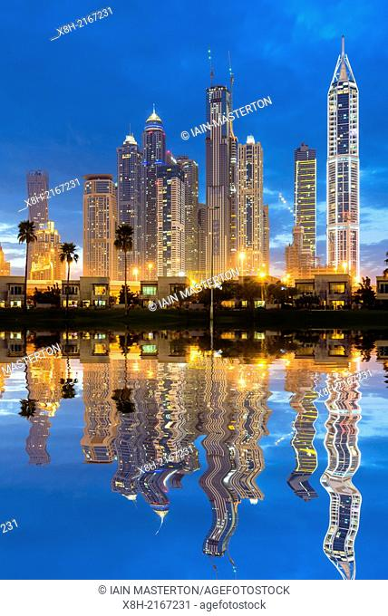 Night skyline of high-rise apartment and office towers in new Dubai Marina district in United Arab Emirates