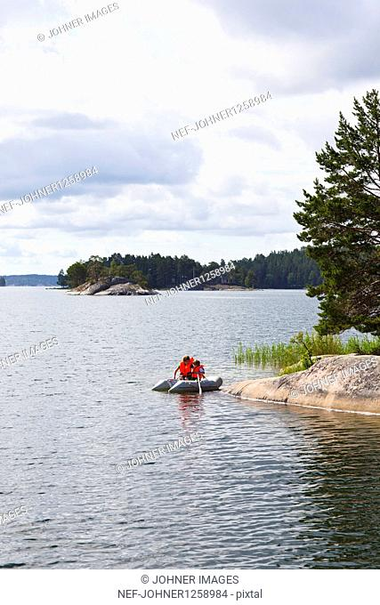 Children rowing in dinghy