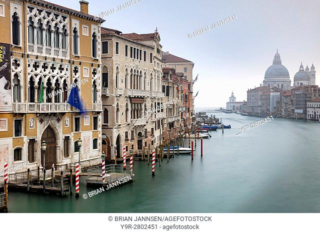 Misty dawn over the Grand Canal, Santa Maria della Salute and buildings of Venice, Veneto, Italy