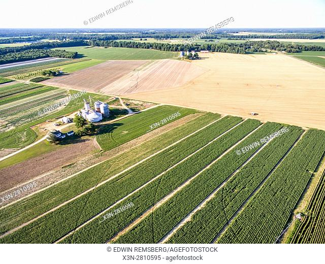 An aerial view of soy bean crops, grain bins, and a pivot irrigation system on a local Maryland farm