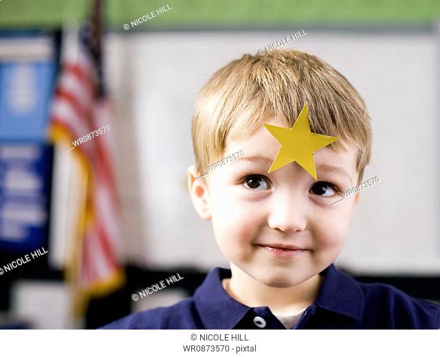 boy with gold star