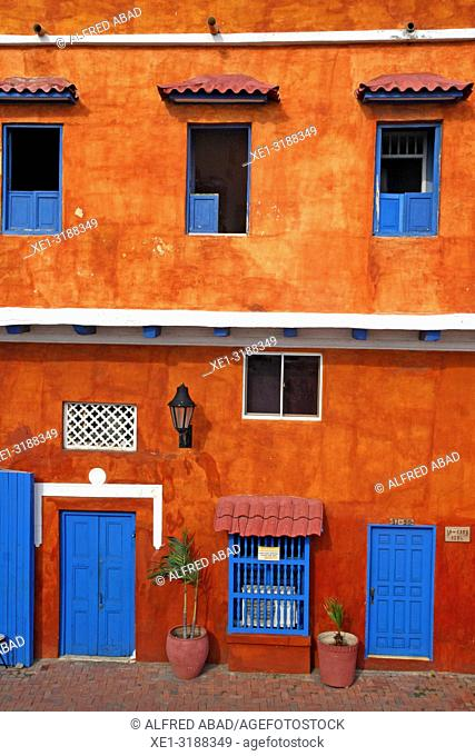 House with red facade and blue doors, Cartagena de Indias, Colombia