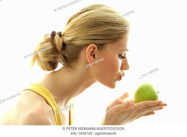 Woman kissing a fresh green apple