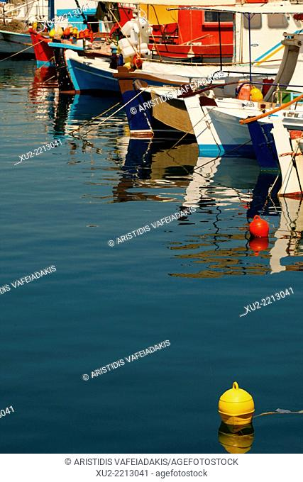 Greek Fishing boats moored in Karistos Harbour Evia Greece