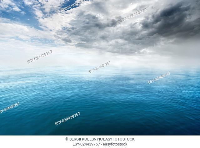 Beautiful blue sea and gray cloudy sky