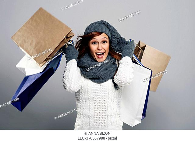 Young excited woman during the winter sale, Debica, Poland