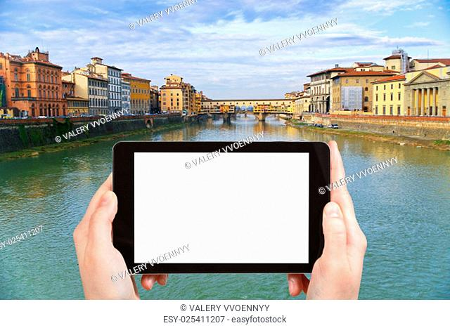 travel concept - tourist photograph Ponte Vecchio on Arno River in Florence city, Italy in sunny evening on tablet pc with cut out screen with blank place for...