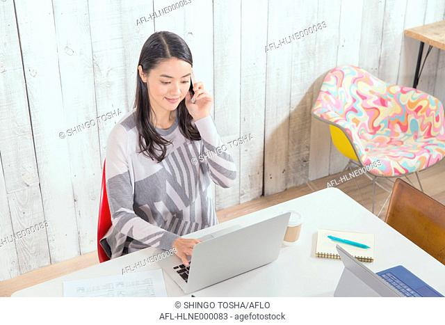 Young Japanese woman working in a stylish office