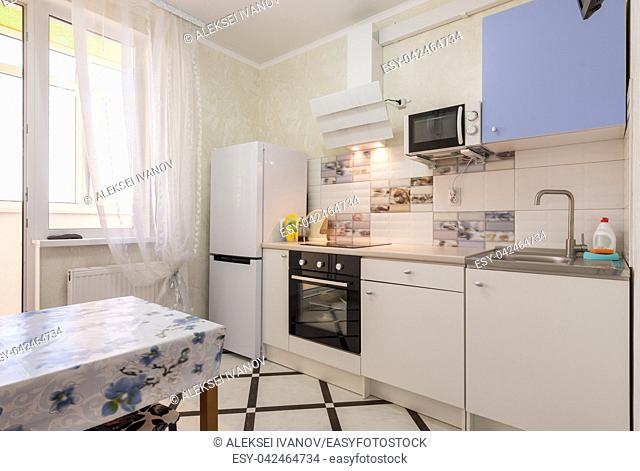 The interior of a small kitchen in the apartment