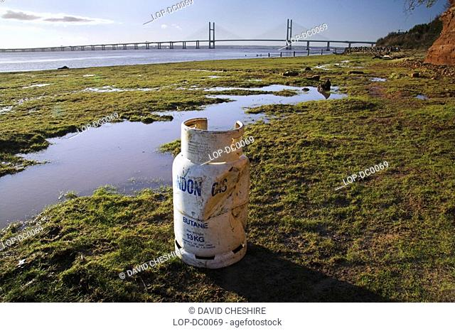 South Wales, Monmouthshire, Chepstow, Discarded butane gas bottle washed up on the shore of theRiver Severn near Chepstow