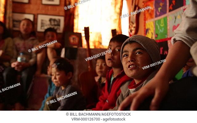 Kathmandu Nepal children sing in music room at childrens home in Eastern Kathmandu, Nepal