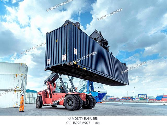 Container lift with shipping container in port