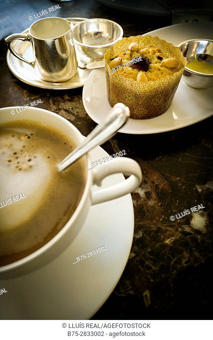 Still life with a cup of coffee, a cake, jug of milk and sugar. England