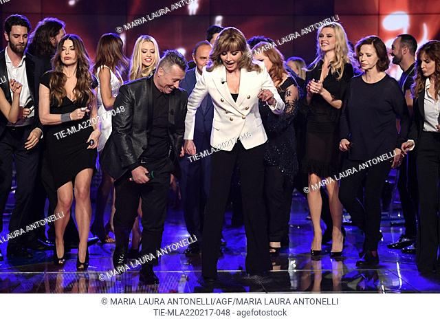 Hosts Paolo Belli, Milly Carlucci dancing with the cast during the tv show Porta a porta, Rome, ITALY-21-02-2017