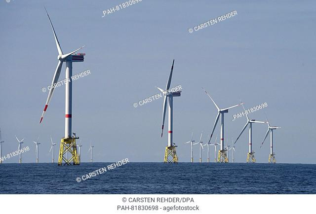 Wind turbines of a wind farm operated by RWElocated on the North Sea some 30 kilometres off Helgoland, Germany, 04 July 2016