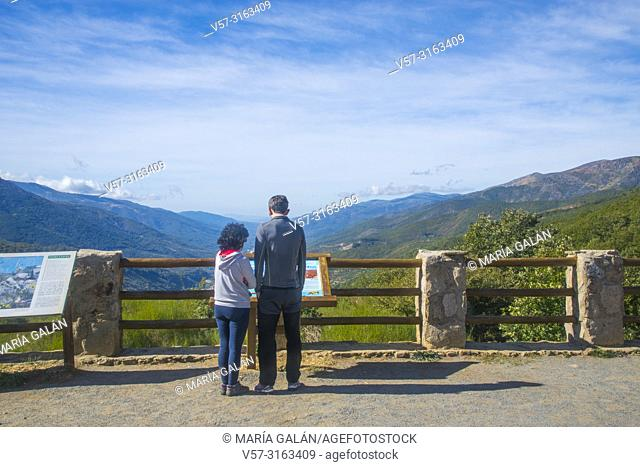 Couple at the viewpoint over Jerte valley. Tornavacas mountain pass, Caceres province, Extremadura, Spain