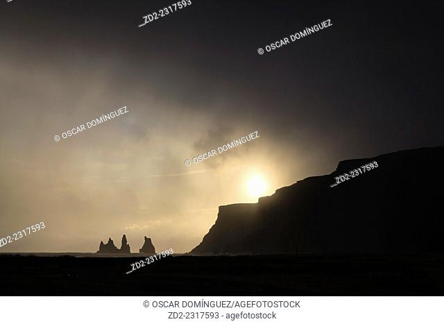 Sea stacks at Reynisdrangar at dusk. Vik. Iceland