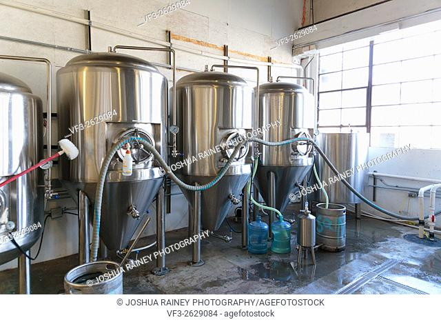 EUGENE, OR - NOVEMBER 4, 2015: Stainless steel commercial beer fermenters at the startup craft brewery Mancave Brewing