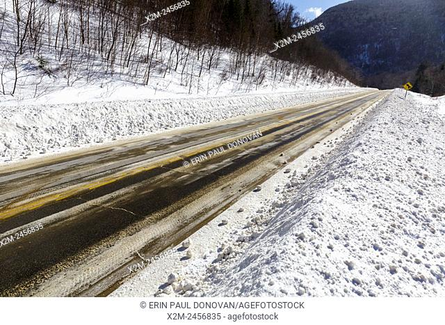 Route 112 in Kinsman Notch of Woodstock, New Hampshire USA during the winter months