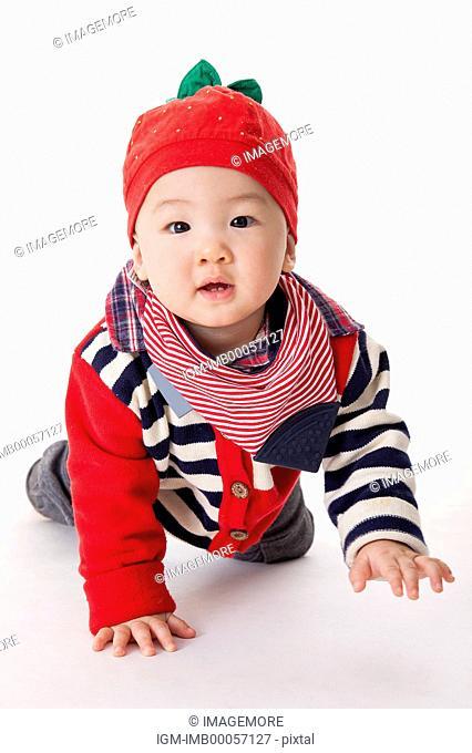 Baby boy smiling at the camera