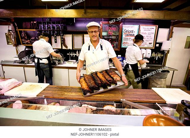Man holding smoked meat