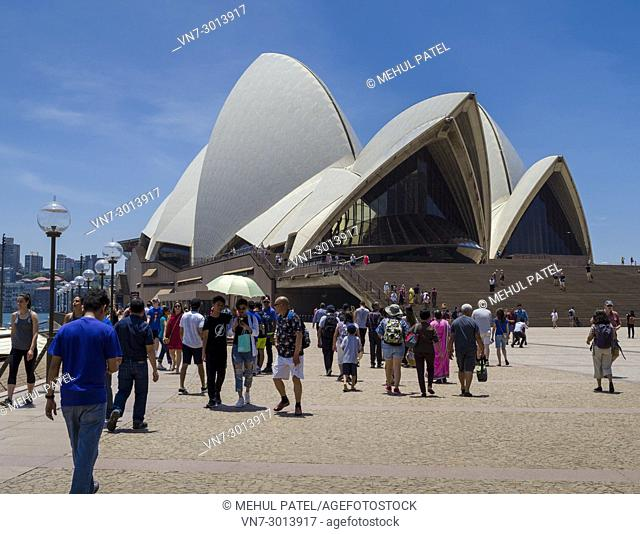 People going to and coming from the Sydney Opera House, Sydney Harbour, Sydney, New South Wales, Australia