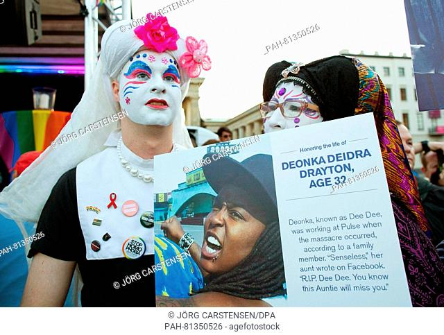 "A photo of one of the vitcims is being held during the vigil """"Berlin for Orlando"""" at the Brandenburg Gate to commemorate the 49 victims of the Orlando..."