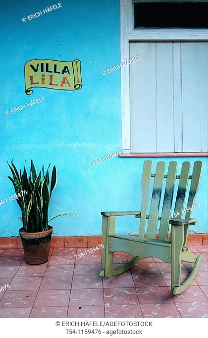 Rocking chair in front of a house in Vinales / Cuba