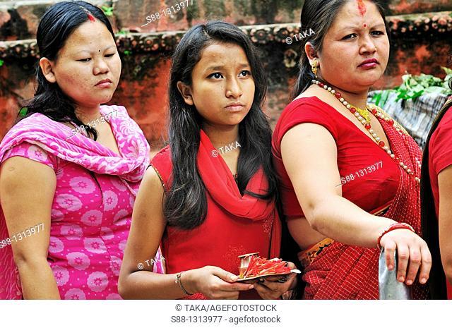 On the day of Krishna's birthday women cueing to get to the Chyasin Dega temple in Hanuman Dhoka Durbar