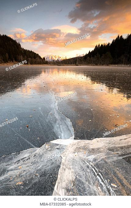 The ice surface of lake in Pian Gembro, Aprica, Province of Sondrio, Valtellina, Lombardy, Italy, Europe