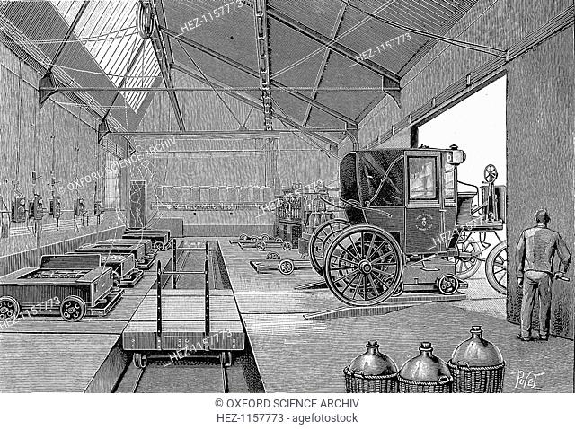 Depot at Rue Cardinet where electrically driven Paris cabs were fitted with freshly charged batteries, 1899. At front right are glass carboys in protective...