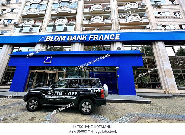 Romania, Bucharest, centre, building of the Blom bank of France, in front of it a car from the security company