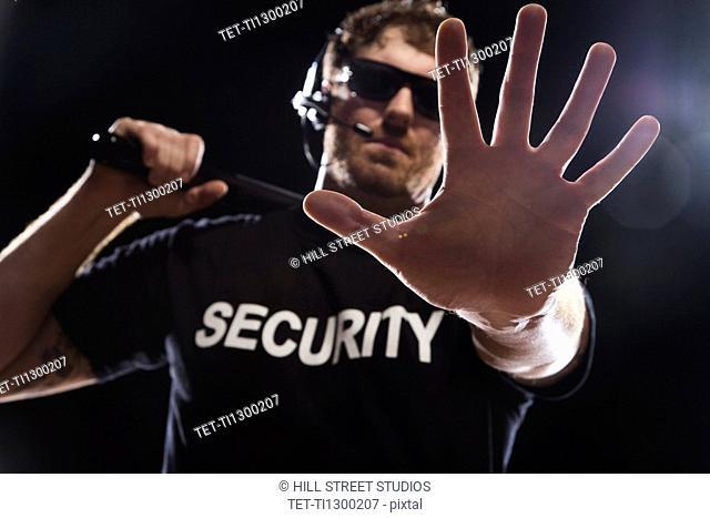 Security guard extending hand