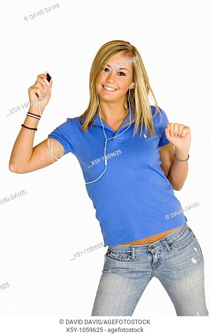 Teenage girl listening to music on an MP3 player