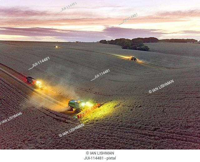Aerial View Of Combine Harvester In Wheat Field At Dusk