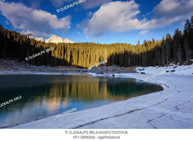Lake Carezza, Ega valley, Nova Levante, Bolzano province, Dolomites, Trentino Alto Adige, Italy, Europe. Lake at thaw