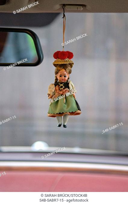 Doll hanging in a car, Biberach, Baden-Wurttemberg, Germany