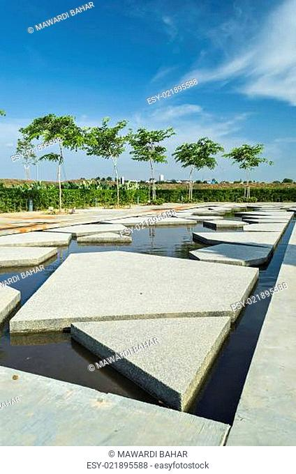 Slab concrete with pattern and reflection at green garden area