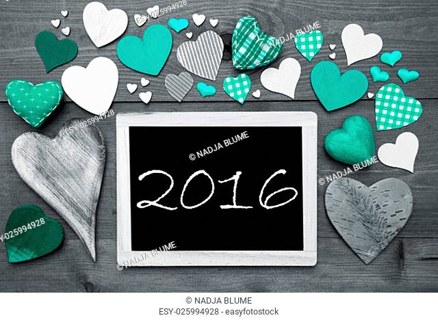 Chalkboard With Text 2016 For New Years Greetings. Many Green Textile Hearts. Wooden Background With Vintage, Rustic Or Retro Style