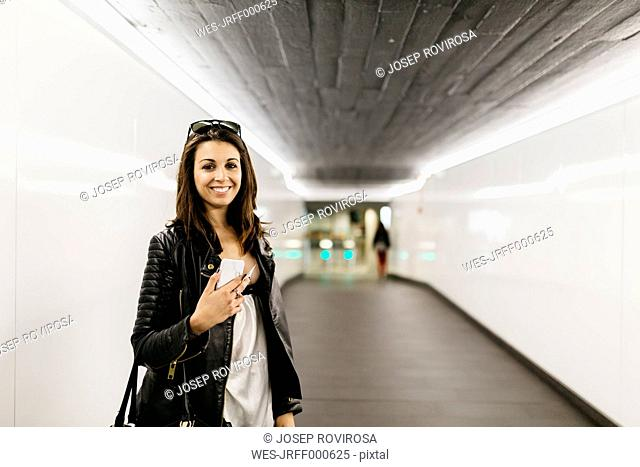 Portrait of smiling young woman in a tunnel