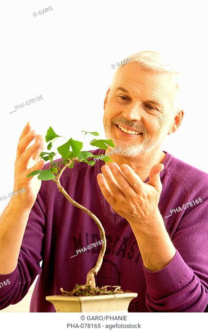 Man with bonsai