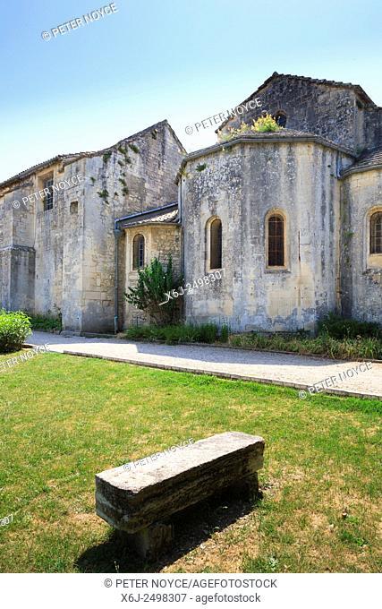 Stone bench in the garden of Maison de Sante Saint Paul Monastery at Saint Remy