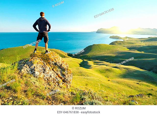 Man enjoy the nature. Sea and mountain