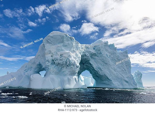 Huge arched iceberg near Petermann Island, western side of the Antarctic Peninsula, Southern Ocean, Polar Regions